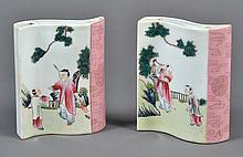 PAIR CHINESE PORCELAIN BRUSH RESTS - Serpentine curved brush rests or holders painted with different images of a teacher and a young...