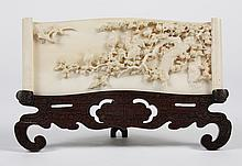 JAPANESE CARVED IVORY PLAQUE OR SMALL SCREEN - The small screen or plaque has finely detailed relief carving of cranes and a gnarled...