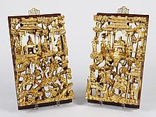 TWO CHINESE ARCHITECTURAL PANELS - Detailed carved gilt wood portrays warriors on horseback and nobles conveying money and campaign...