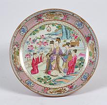 CHINESE PORCELAIN FAMILLE ROSE PORCELAIN PLATE - Portraying a lady of means, accompanied by two attendants, being offered a box-shap...