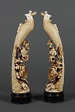 PAIR CHINESE CARVED IVORY PHOENIX - Configured with one foot on a rocky shelf and the other foot curled around a flower stock. Crest...