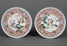 PAIR CHINESE PORCELAIN HANGING PLATES - Having two different center scenes; one with two women gathering flowers and the second show...