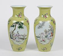PAIR CHINESE PORCELAIN VASES WITH GREEN GLAZE - Baluster shape with an impressed furled scroll design in the yellow-green glaze. Two...