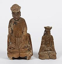 TWO CHINESE WOODEN TEMPLE FIGURES - Seated; larger having scroll-form pedestal. Served as reliquaries; space in smaller figure is cl...