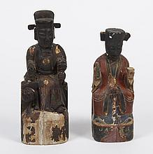 TWO CHINESE TEMPLE FIGURES - Carved wood. Seated, taller with a fu dog at his side and dragon on shoulder. Shorter has writing on ba...