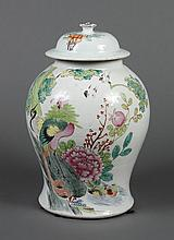 LARGE FAMILLE ROSE COVERED JAR - Off-white glaze background; polychrome scene of a water-garden including a crane, phoenix, pair of...
