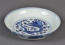CHINESE PORCELAIN B/W DISH - Decorated with several dragons circling the outer wall and one on the bowl floor all amidst fire symbol...