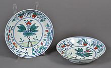 PAIR CHINESE PORCELAIN DOUCAI BOWLS - Contrasting red, green and yellow colors portray a stylized pomegranate tree and clusters of b...