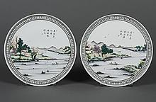 PAIR CHINESE PORCELAIN HANGING PLATES - With a landscape scene of lake and shoreside architecture and trees. Rimmed with a black dia...