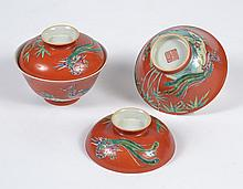 PAIR CHINESE PORCELAIN CORAL RED BOWLS - Covered bowls with coral red exterior walls decorated with bamboo and two Phoenix. Bamboo a...