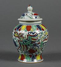 CHINESE POLYCHROME CERAMIC VESSEL - Covered, with pointed finial. Geometric and floral decoration; phoenix motif on either side. Stam..