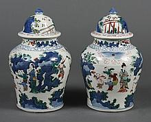PAIR OF CHINESE PORCELAIN WUCAI COVERED JARS - Baluster shape with underglaze blue and overglaze enamels in traditional colors. Pain...