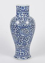 CHINESE PORCELAIN B/W VASE - Baluster form with a short linear neck; decorated in an all-over stylized foliate and floral design. Ap...