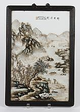 FRAMED CHINESE PORCELAIN PLAQUE - Signed with calligraphy and seal mark, painted with a landscape scene of mountains, trees, archite...