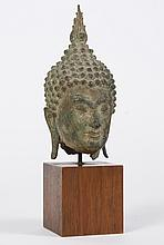 THAI OR BURMESE STONE BUDDHA HEAD - With tight knotted hair and flame-form ushnisha. Hollow interior. Mounted by metal dowel to wood...