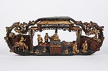 CHINESE PAINTED AND GILTWOOD CARVED ARCHITECTURAL FRAGMENT OF FIGURES - Six figures and a horse are shown in an architectural settin...