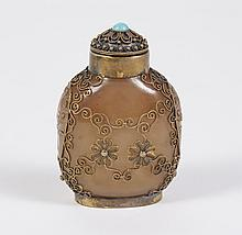TRANSCLUCENT BEIGE GLASS SNUFF BOTTLE - With turquoise stone on beaded cap; symmetrical gold tone filigree throughout. Two flower mo...
