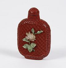 CARVED RED LACQUER SNUFF BOTTLE - Matte; meander pattern covering top and sides. On each face is an embedded square pattern onto whi...