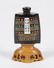 BROWN HORN SNUFF BOTTLE - One face shows orange and green enamel dotting, gold-etched ornamentation, and an ivory insign