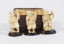 THREE CARVED IVORY NETSUKE - Portraying three of the 7 Lucky Gods; Ebisu; holding a sea bass, Daikoku standing by a rice bale and ho...