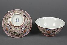 PAIR CHINESE PORCELAIN FAMILLE ROSE BOWLS - Pink ground with mille fleur decoration on the exterior wall; having a Dharma Wheel on t...