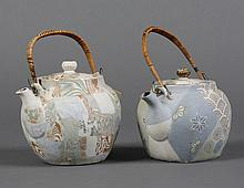 TWO MARBLE-STYLE BANKO TEAPOTS - In pastel colors, with gilt trim, chrysanthemum finials, and fiber-wrapped/braided wire handles. Al...