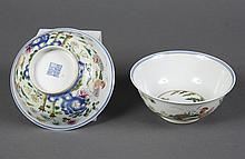 PAIR OF CHINESE PORCELAIN BOWLS WITH ROOSTERS - Showing a rooster, hen and chicks in a flower garden with peonies and foliage. Roost...