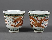 PAIR OF SMALL CHINESE PORCELAIN CUPS - Decorated with a gold and red dragon and fire symbols on the exterior. Character marks on bas...