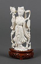 CHINESE CARVED IVORY FIGURE PORTRAYING QUAN YIN - Standing figure of Quan Yin in a Phoenix headdress holding a lotus branch and a fa...