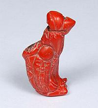 VIETNAMESE CARVED RED CORAL PENDANT - Piece of orange-red branch coral, carved with image of a happy old man with his walking stick....
