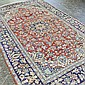 ADDENDUM: CARPET: HANDWOVEN PERSIAN MESHAD - Wool on a cotton warp with large multi-lobed medallion on a red field surrounded by a d...