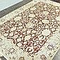 ADDENDUM; CARPET: HANDWOVEN MAHAL - Wool on a cotton warp with brick-colored field, floral and palmette designs and cream colored bo...