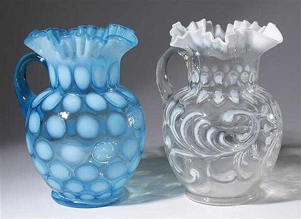 TWO VICTORIAN GLASS PITCHERS - One Fenton-style blue coin dot pitcher with ruffled edge. One white on clear feather patterned pitche...