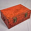 STORAGE TRUNK - Antique pigskin over wood frame with red lacquer toning, remnants of polychrome accents and iron hardware. Condition...