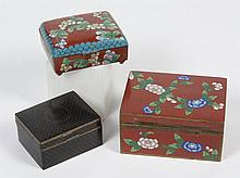 THREE CHINESE CLOISONNE HINGED BOXES - Includes two red ground boxes with chain pattern and floral design and one black box with sca...
