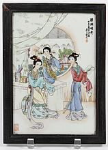 CHINESE PORCELAIN FAMILLE VERTE PLAQUE - Framed plaque depicts three women in an interior dressing room with one woman outside at th...