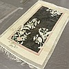 TEXTILE: HAND-KNOTTED CHINESE SILK - Textile with faded black field with large scale asymmetric floral designs crossing bands of silv..