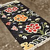 ADDENDUM; CARPET: HANDWOVEN NEPALESE - Wool on a cotton warp borderless style with stylized floral and vine devices on a black field...