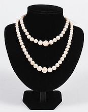 TWO PALE CORAL ROUND GRADUATED BEAD NECKLACES - The graduated size bead necklaces are 14