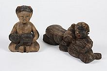 TWO CHINESE CARVED WOOD FIGURES - One is of a young girl holding a cat; the other portrays two figures of children sleeping. It is t...