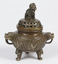 SMALL BRONZE CHINESE CENSER WITH FU LION - Tripod with Fu lion handles and masks on feet. Having a Fu lion finial on cover and embos...