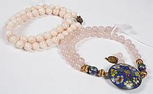 TWO ROUND BEAD NECKLACES: PINK QUARTZ AND PINK CORAL - The pink quartz beads are 5 mm in diameter, interspersed with enamelwork bead...