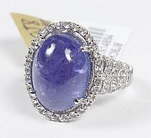 CABOCHON TANZANITE AND TOPAZ RING - This beautiful platinum plated sterling silver ring features a large cabochon cut violet-blue ta...