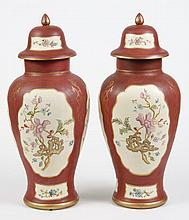 PAIR OF SISTER PARISH CERAMIC MANTEL URNS - Flatback, with caps, painted with flowers in a Colonial palette and style often used in...