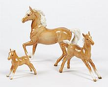THREE PORCELAIN BESWICK HORSES - Includes a stallion and two foals; all are palomino with white manes and tails. Marked Beswick Engl...