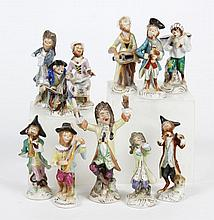 GERMAN PORCELAIN FIGURES: MONKEY BAND - After the 18th century Meissen Monkey Band created in the singerie style. Eleven pieces incl...