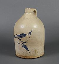 ANTIQUE STONEWARE JUG WITH BLUE BIRD - Artistic portrayal of a cobalt bird on a branch; strap handle. Stamped with a 3.(Gal). Manufa...
