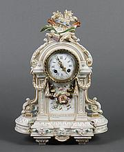 MANTEL CLOCK; L'MARTI ET CIE MEDAILLE DE BRONZE - White footed porcelain clock of Romanesque style, with gold highlights, applied fl..