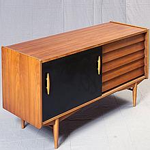 CREDENZA - Vintage walnut, rectilinear design, with single sliding door compartment with black laminate face abreast of five stacked...