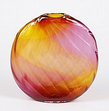 DAN BERGSMA ART GLASS VASE - Hand blown vase in a flat ovoid form with intersecting wave lines creating a grid pattern; in shades of